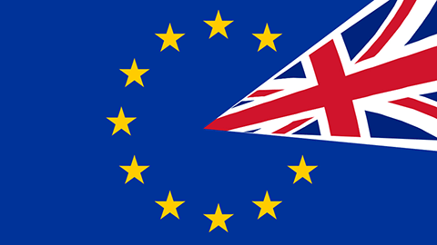 The Union Jack overlaying two stars on the flag of Europe