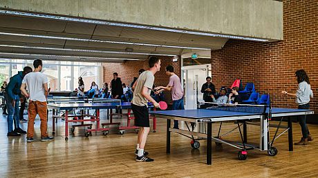 Students playing table tennis in Mandela Hall