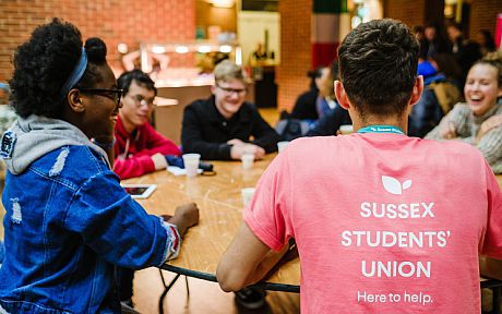 Students around a table in the Students' Union